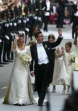 NORWEGIAN PRINCESS MARTHA LOUISE AND HER HUSBAND ARI BEHN WALK ON A STREET AFTER WEDDING AT TRONDHEIM CATHEDRAL